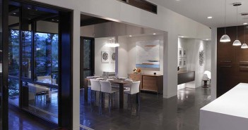 Contemporary furniture is complemented with the paintings done by Johnny. A hallway at the far end of the dining area leads to a powder room and a media room.